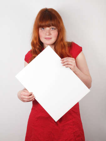 young woman holding blank sign photo