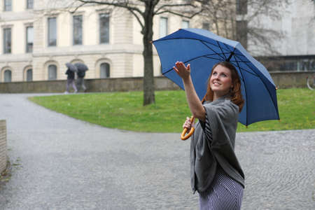 young woman enjoying the rain      Standard-Bild