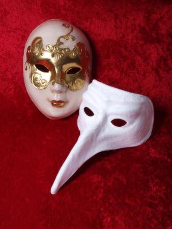 2 masks on red velvet