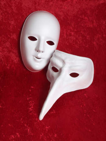 2 masks on red velvet    Stock Photo