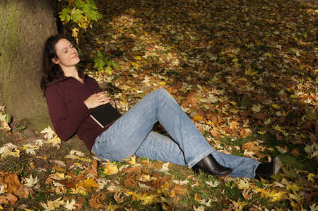 woman relaxing in autumn scene