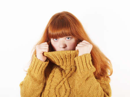 woman hiding in her turtle neck jumper