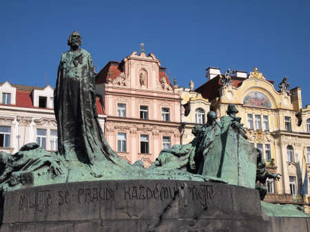 Prague: Jan Hus memorial and Art Nouveau buildings Stock Photo