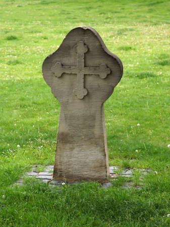 weather beaten: grave stone