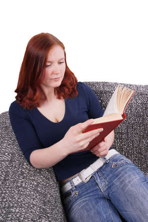 woman relaxing with book on couch photo