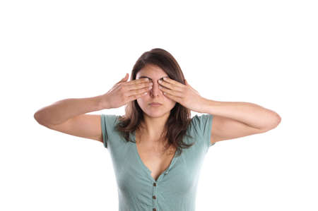 unsighted: woman covering her eyes