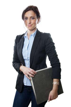 women in jeans: business woman holding folder Stock Photo