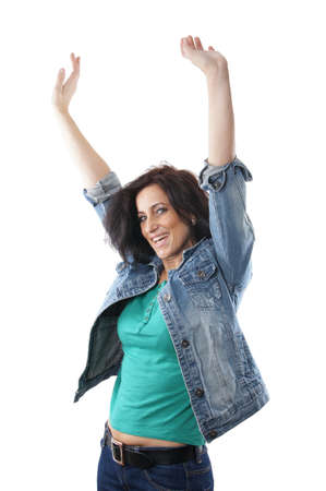fan dance: middle aged woman cheering with raised arms Stock Photo