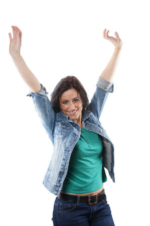 middle aged woman cheering with raised arms photo