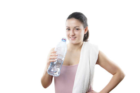 sporty young woman with towel and water bottle Stock Photo - 18521696