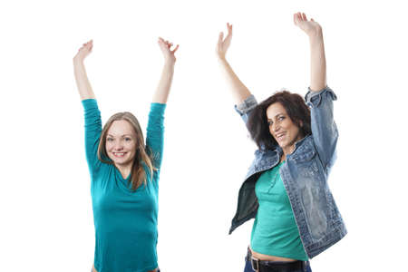young blonde and middle aged brunette woman cheering with raised arms photo