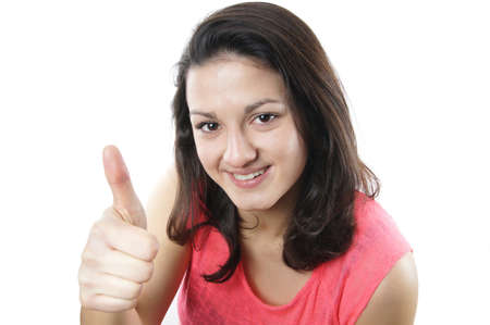 teenage girl giving thumbs up photo