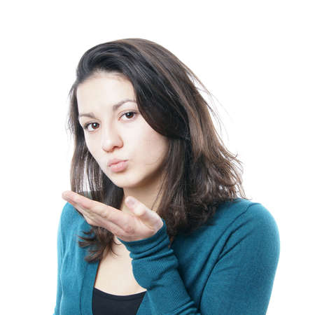 puckered: teenage girl blowing a kiss Stock Photo