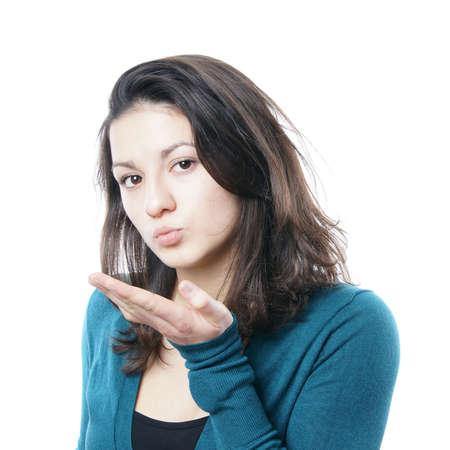 puckered lips: teenage girl blowing a kiss Stock Photo