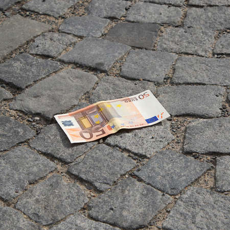 cobbled: 50 Euro banknote lying on the ground