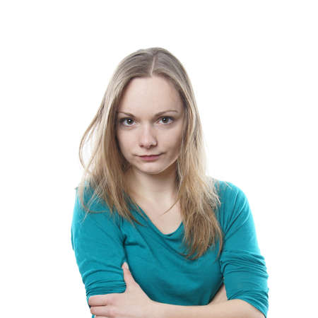 young blonde woman is making a face