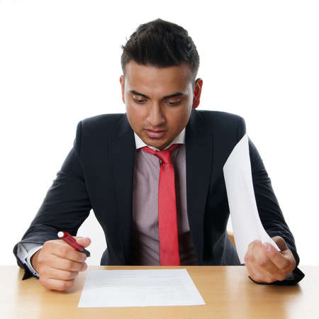 man reading contract at his desk Stock Photo