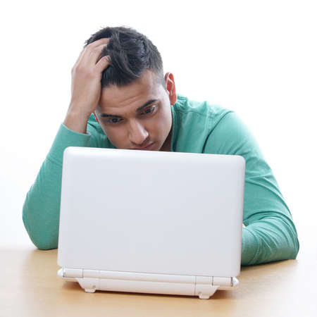 young man staring at laptop Stock Photo - 22814255