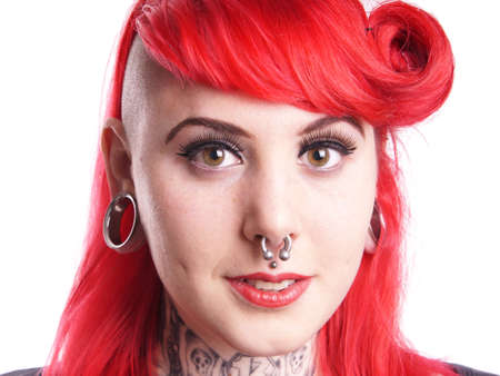 young woman with facial piercings and tattoos Stock Photo