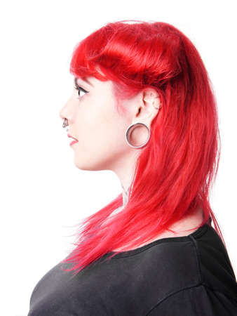 young woman with facial piercings and tattoos 版權商用圖片
