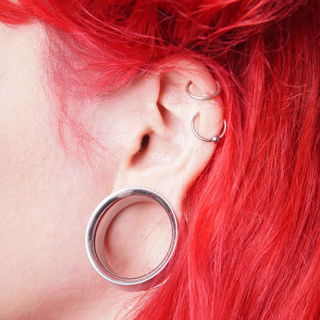 piercing: stretched ear lobe piercing with flesh tunnel