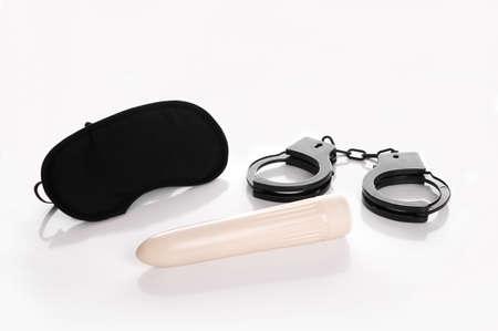 eye mask, handcuffs and dildo Stock Photo - 24250194