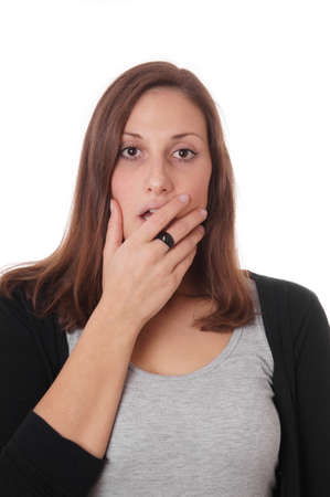 horrified: surprised young woman covering her wide open mouth with her hand Stock Photo