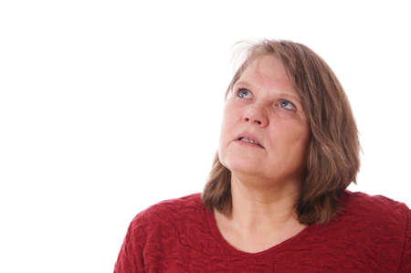 senior woman looking up thinking