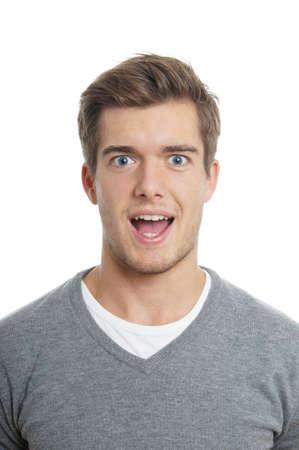 man face: jonge man op zoek verrast Stockfoto