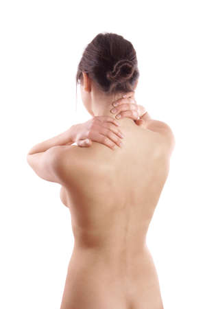 topless young woman with back or neck pain seen from behind photo