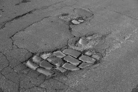pothole   road damage photo