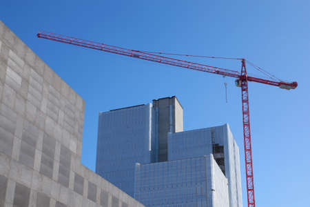 multi story: unfinished tower building with scaffolding and crane Stock Photo