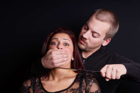 man holding woman hostage at knifepoint photo