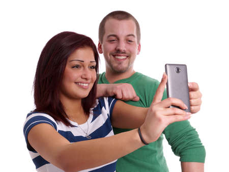 happy couple taking a self portrait with cell phone camera photo