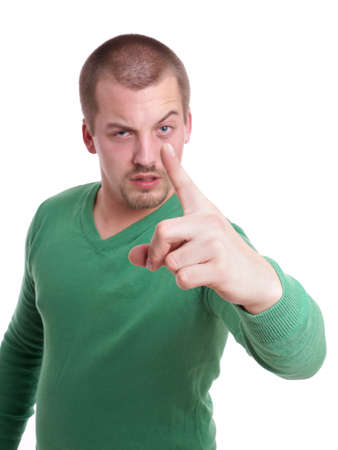 threatening: tough guy making threatening gesture wit his finger