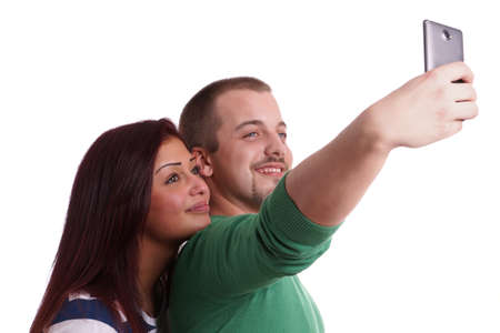 self expression: happy couple taking a self portrait with smart phone camera