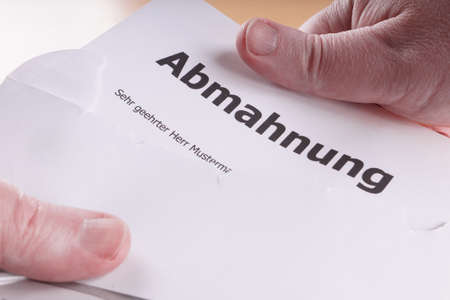 German written warning similar to a cease-and-desist letter Stock Photo