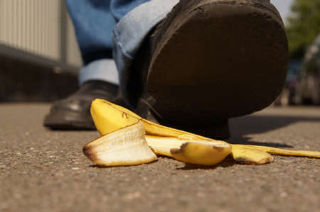 banana skin: person about to slip on a banana peel or banana skin Stock Photo