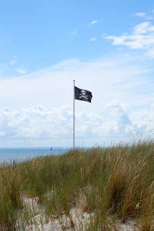 hijack: pirate flag at a baltic sea beach Stock Photo