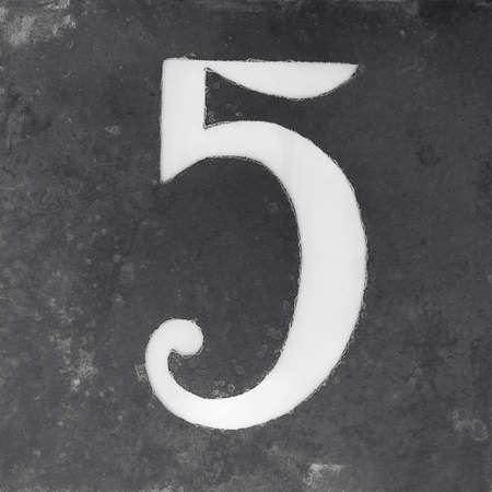 five objects: weathered house number 5 sign