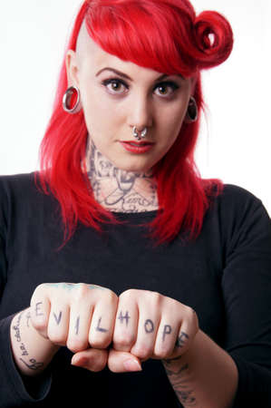 freaky: young woman with piercings and tattoos