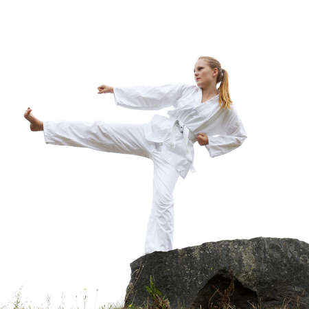 young woman practising taekwondo kick photo