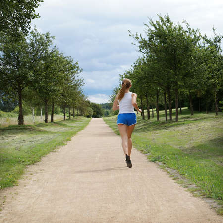 female jogger seen from behind photo