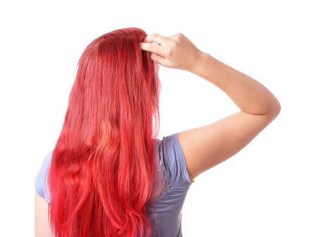 hair back: rear view of a woman thinking and scratching her head Stock Photo