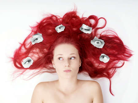 young woman feeling watched by multiple eyes surveillance or privacy concept                                photo