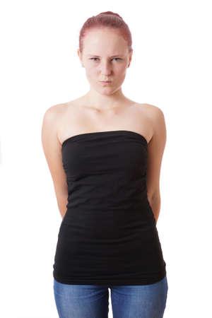 avergonzado: Mujer joven tímida está tirando de una cara Foto de archivo