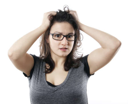 anxious stressed young woman tearing her hair out