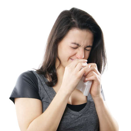 young woman blowing nose with paper tissue photo