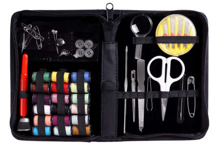sewing kit with assortment of yarns and needles photo