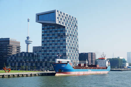 euromast: Rotterdam, Netherlands - September 17, 2014: Scheepvaart en Transport College (Shipping and Transport College) on September 17, 2014 in Rotterdam harbor. The STC  is housed in a building in the shape of the number 1.